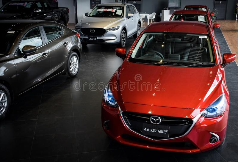 BANGSAN THAILAND MAY 2018 This car new mazda 2 brand japan red color on parking street for customer so parked in showroom thailand stock photo
