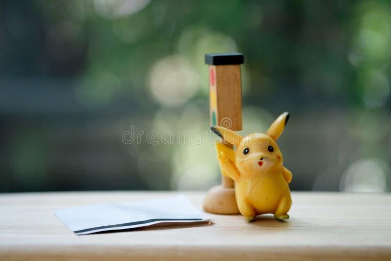 Banguecoque, Tail?ndia - 11 de maio de 2019: Anima??o de Pikachu do detetive de Pokemon no teatro de filme em Tail?ndia imagem de stock royalty free