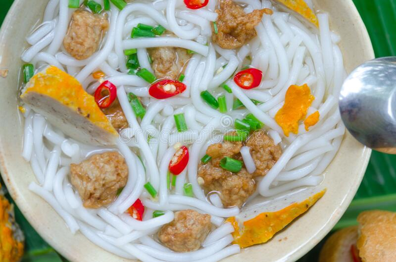 Banh Canh - Rice noodles soup with fried fish ball and Banh Mi Cha Ca - Vietnamese bread with fried fish and chili fish sauce. Inside. This is a typical combo stock photography