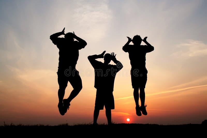 banhoppningmansilhouettes tre royaltyfria bilder