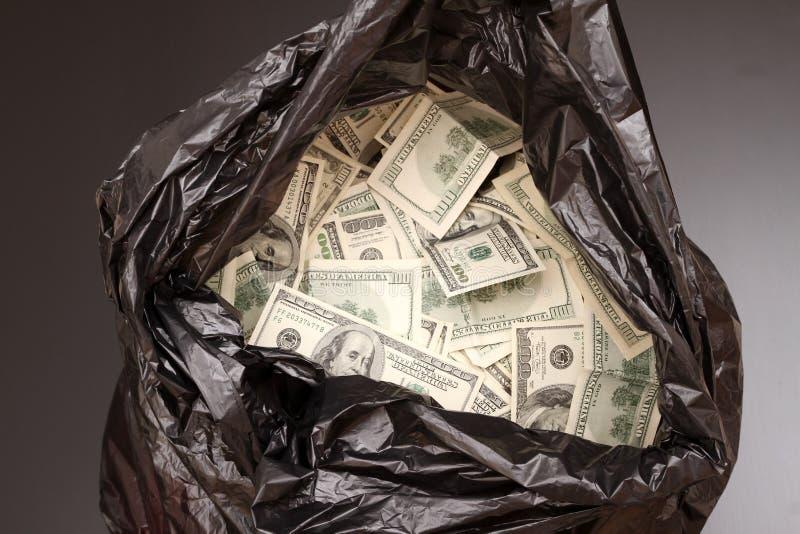 Banialuki torba z dolarami obrazy royalty free