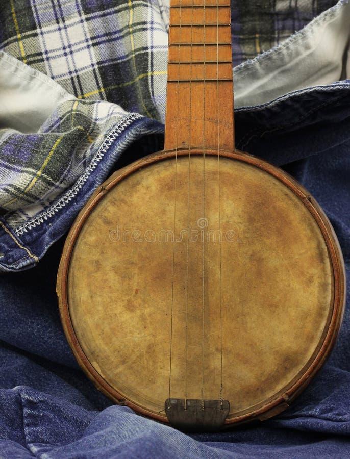 Download Banjo on Denim stock photo. Image of tune, denim, guitar - 21847714