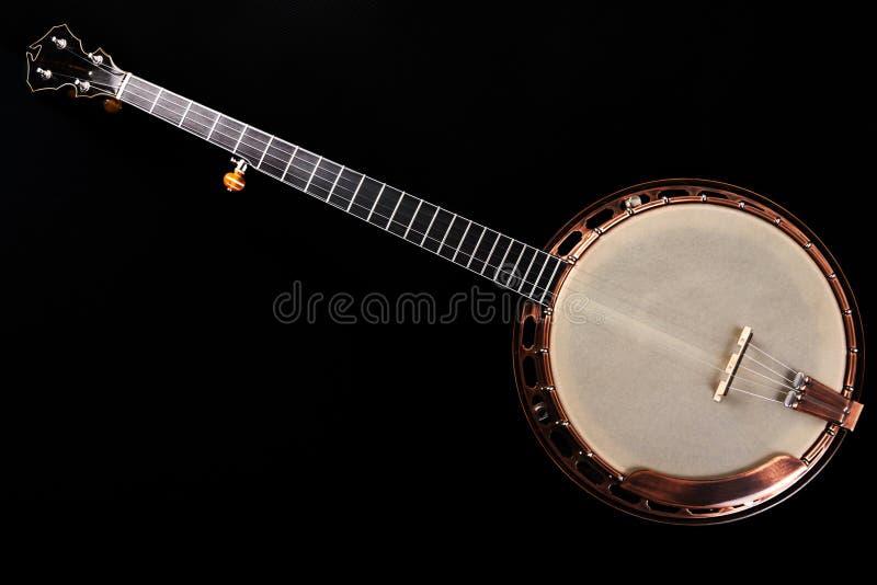 Banjo metalic on black background stock photos
