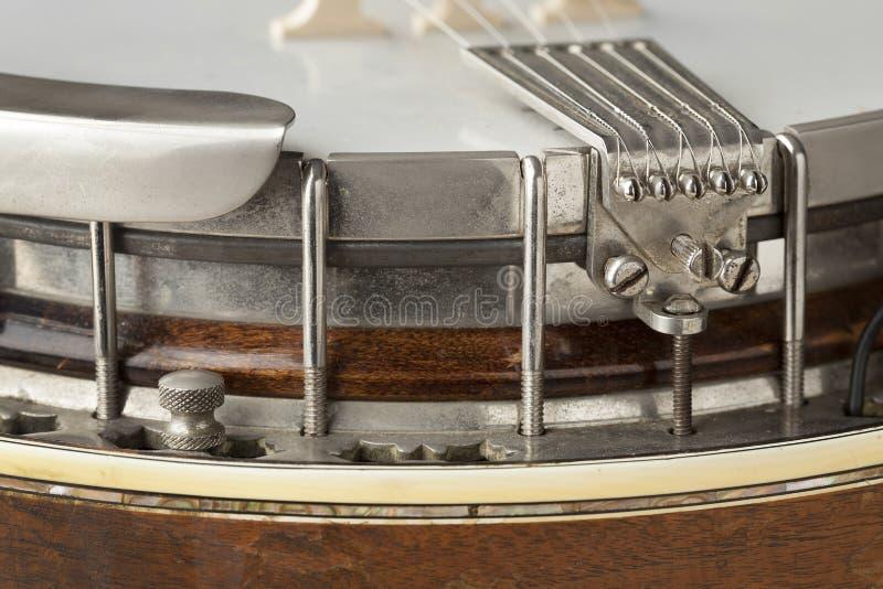 Banjo tailpiece. Banjo instrument tailpiece close up royalty free stock photos