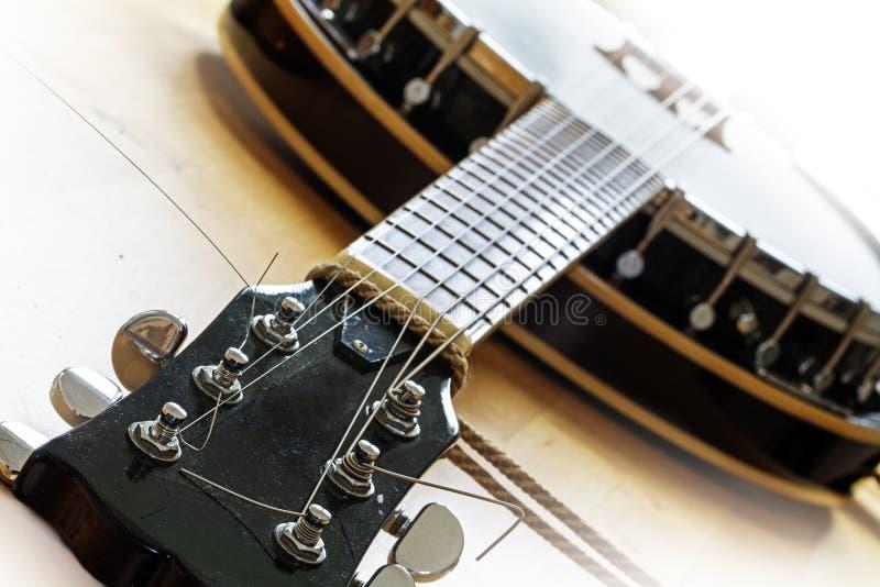 Banjo usado, detalhe ocidental do instrumento de música, foto de stock
