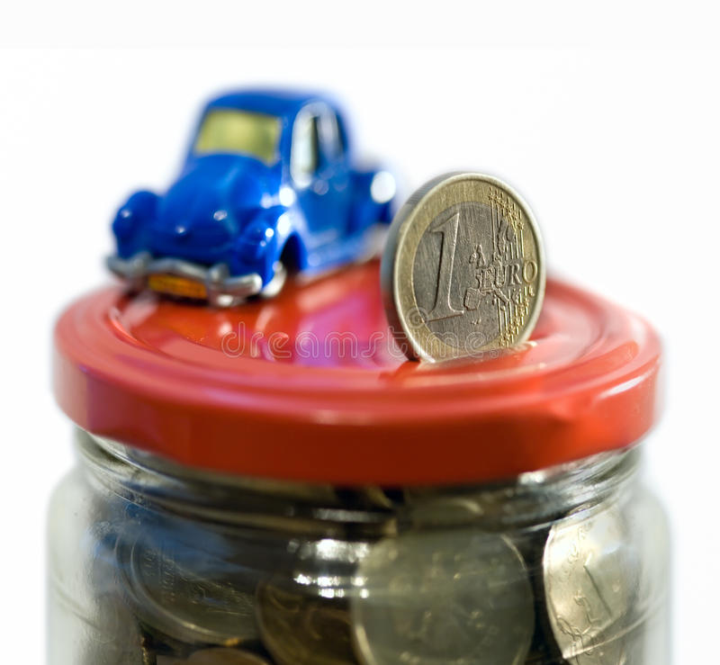 Bank. Red car over a lot of golden coins (isolated on white royalty free stock images