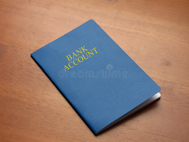 Bank Account. A Bank Account Book on a wooden desk top royalty free stock photo