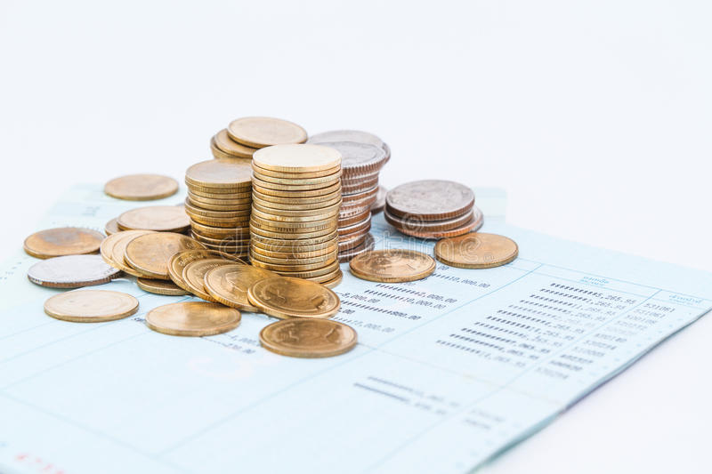 Bank account book. Coins on bank account book stock photo