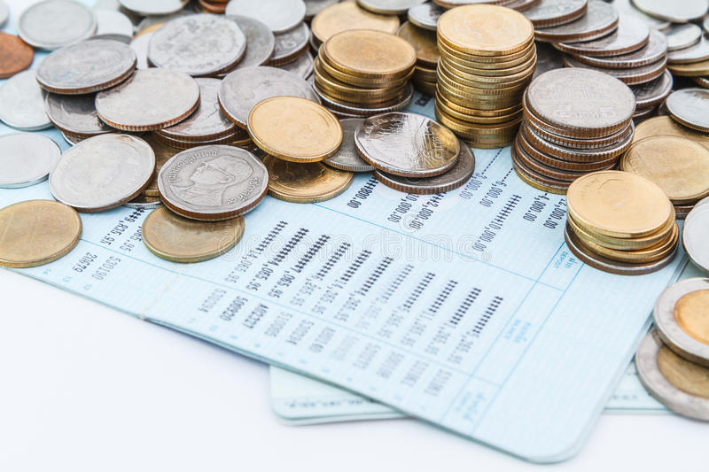 Bank account book. Coins on bank account book stock image