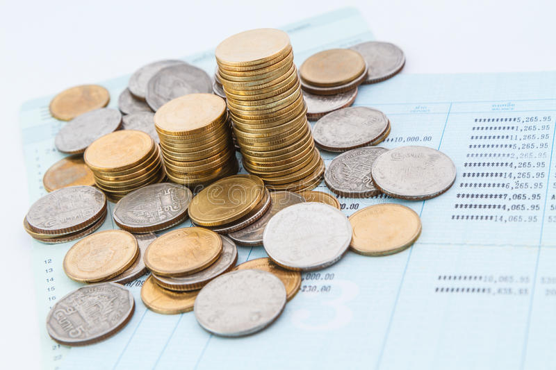 Bank account book. Coins on bank account book stock images