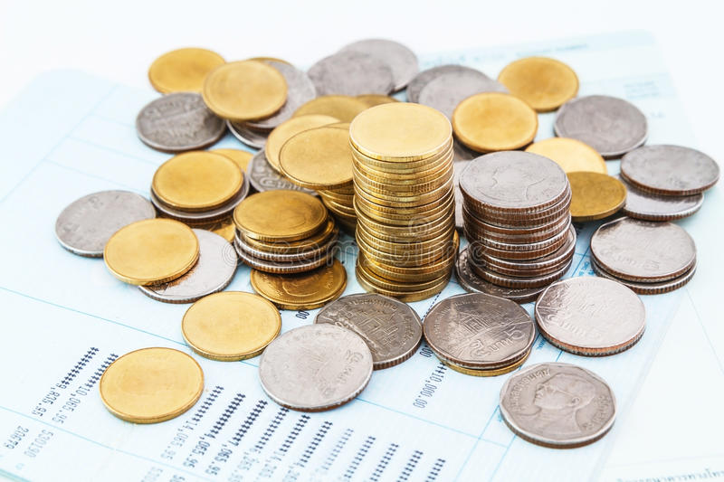 Bank account book. Coins on bank account book royalty free stock image