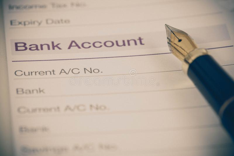 Bank account in book note with fountain pen. In color royalty free stock photography