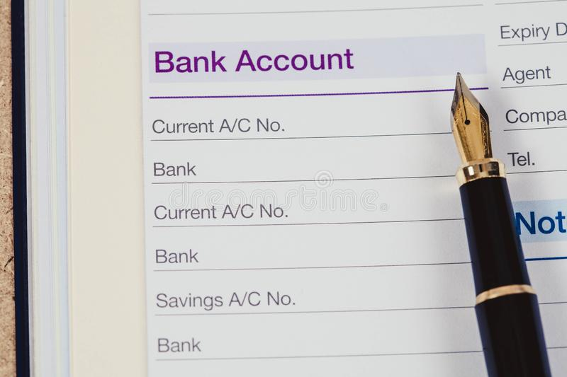 Bank account in book note with fountain pen. In color royalty free stock photos