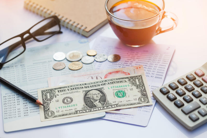 Bank account, Pencil, dollar, cions and calculator with a cup o stock images
