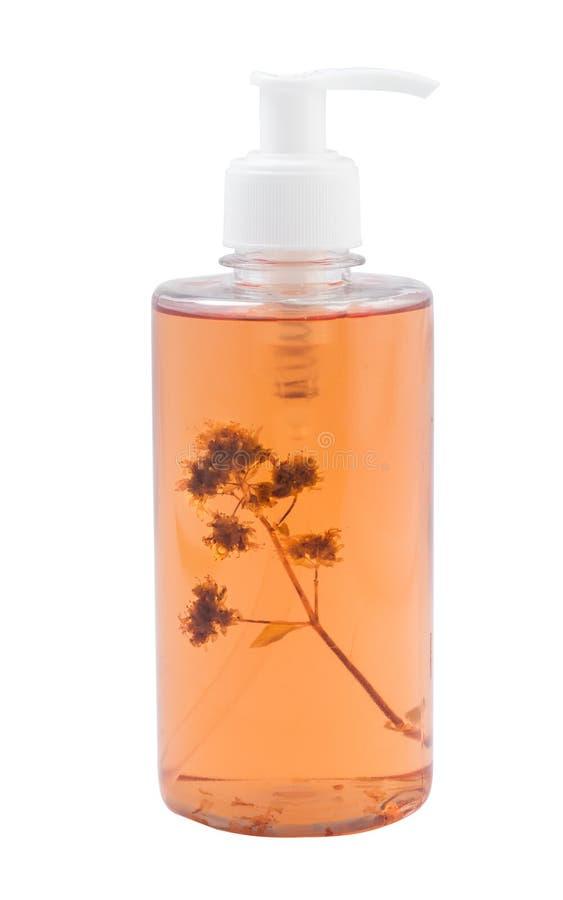 Bank av schampo med en kvist av lin arkivfoton