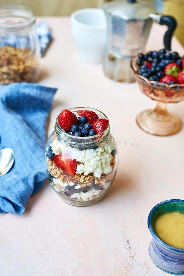 Bank with berries, cottage cheese and granola royalty free stock photography