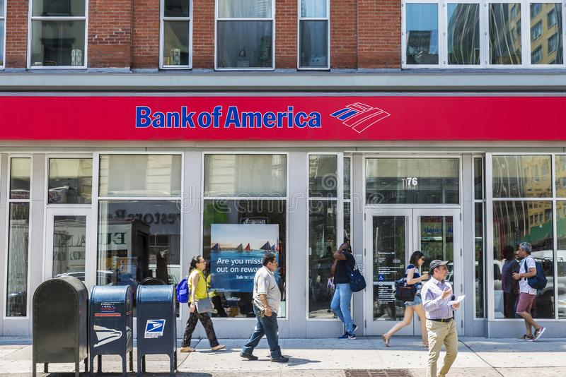 Bank branch of Bank of America in New York, USA. New York City, USA - July 26, 2018: Facade of a bank branch of Bank of America on the street with people around royalty free stock photo
