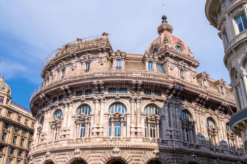Bank building in Piazza De Ferrari. Blue sky on background. Genoa, Italy royalty free stock photography