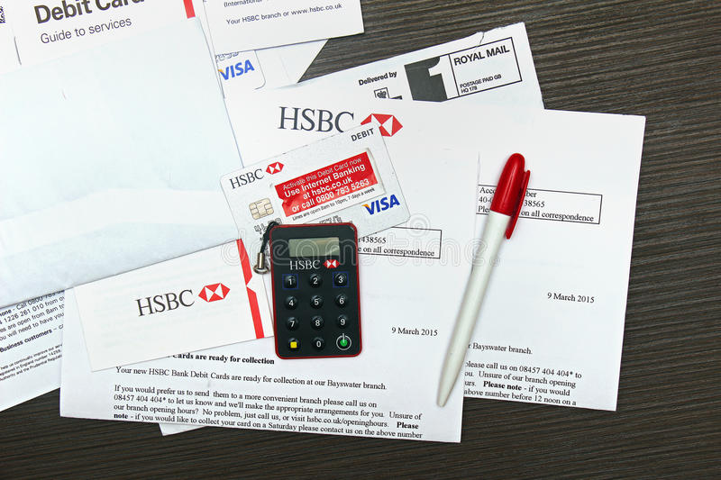 Bank card. London, UK - April 14, 2015: HSBC Visa debit card activation papers with secure key delivered by mail. HSBC is one of the largest banking and royalty free stock photos