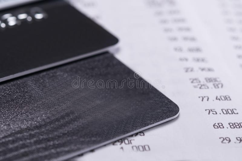 Bank cards on a sales receipt from a store, background close-up royalty free stock images