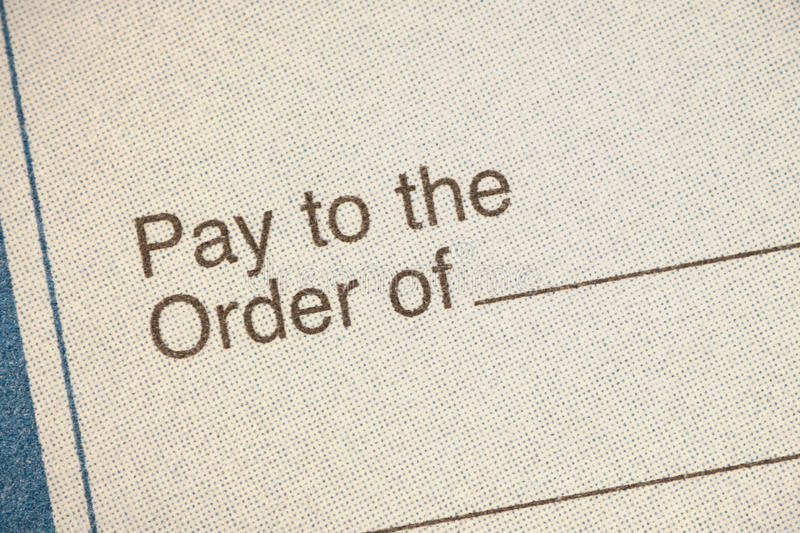 Bank check. Closeup pay to order of stock images