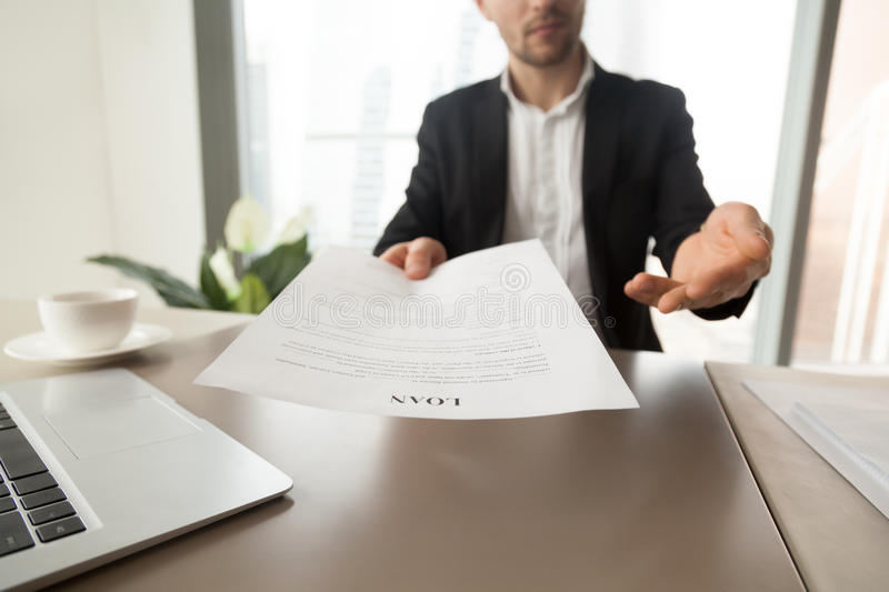 Bank employee offers to read loan agreement form stock photo