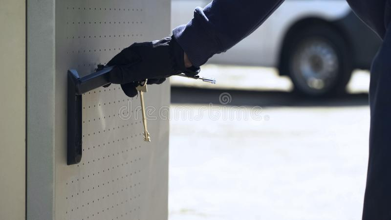 Bank employee opening ATM safe with keys to load storage with cash, security stock photo