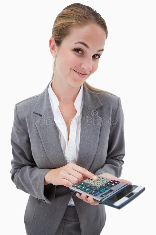 Bank employee with pocket calculator. Against a white background royalty free stock photos