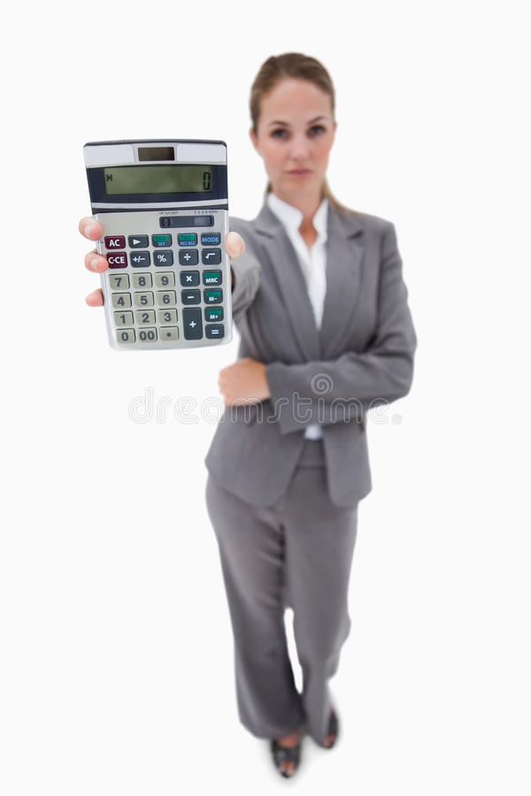 Bank employee showing her hand calculator. Against a white background stock photos