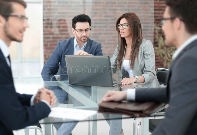 Bank employees work with customers at the Desk. Business concept stock photo