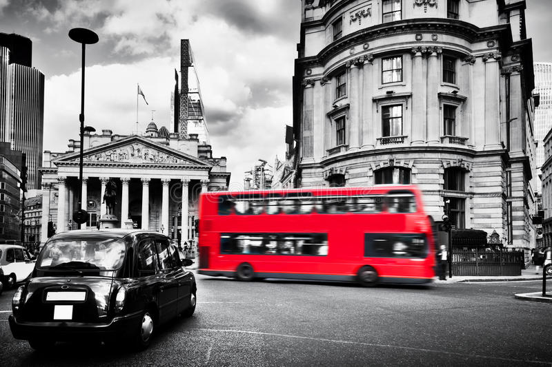 Bank of England, the Royal Exchange in London, the UK. Black taxi cab and red bus. royalty free stock image