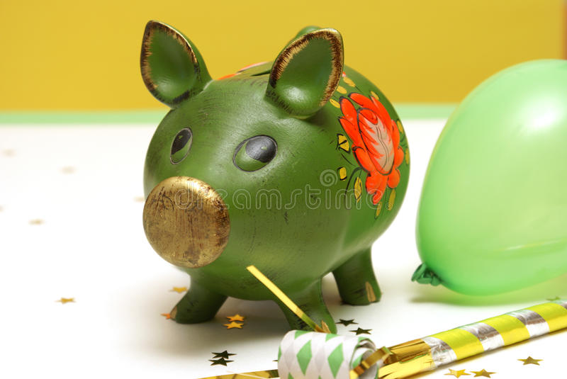 Bank Holiday. A pig bank celebrates his day off for the holiday royalty free stock photo