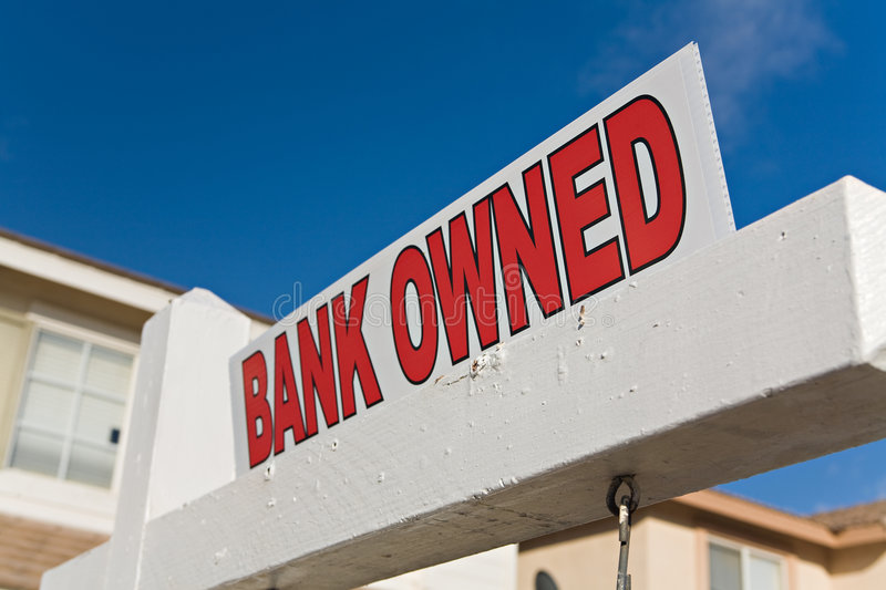 Bank Owned Foreclosure. A real estate sign showing the property is a Bank Owned foreclosure royalty free stock photo