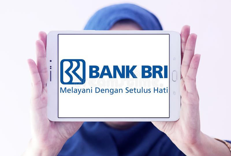 Bank Rakyat Indonesia , Bank BRI, logo. Logo of Bank Rakyat Indonesia , Bank BRI,on samsung tablet holded by arab muslim woman. Bank BRI is one of the largest stock photo