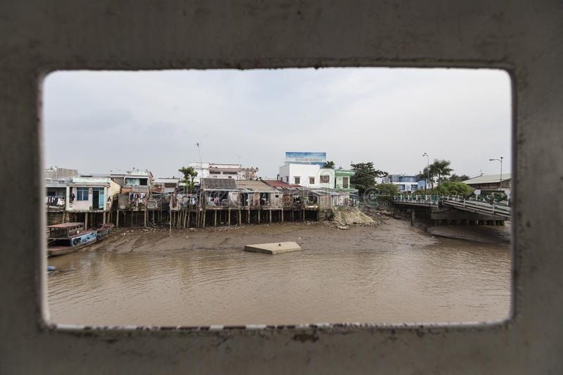 Polluted river. Poor houses at Saigon river which is very dirty and dangerously polluted royalty free stock photography