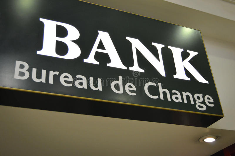 Bank Sign - Bureau de Change. A service for foreign travelers needing to convert currency to the locally accepted cash offer, in the country they are traveling royalty free stock photo