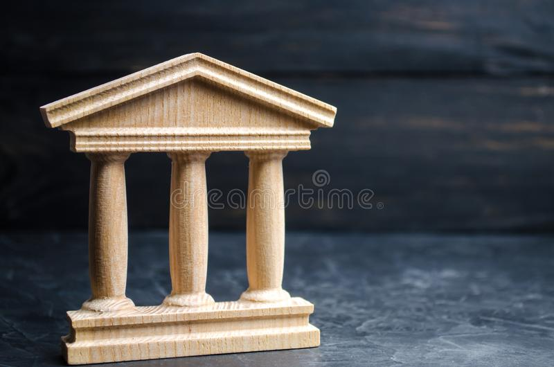 Bank. State Building. wooden government building on a black background. concept of state administration and economic institutions. Municipality, government stock photo