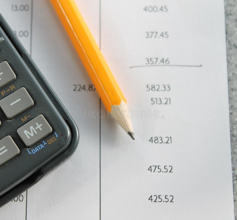 Maths tax Bank statement with pencil and calculator. Maths mathematics Bank statement with pencil and calculator close up royalty free stock photo