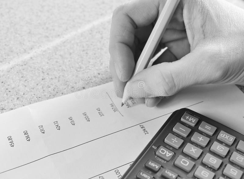 Maths tax Bank statement with pencil and calculator. Close up royalty free stock image