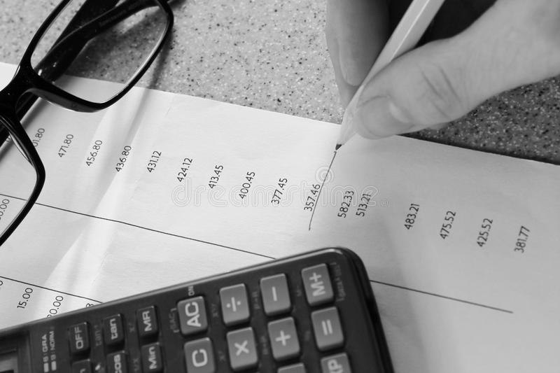 Bank statement with pencil and calculator. Close up stock image