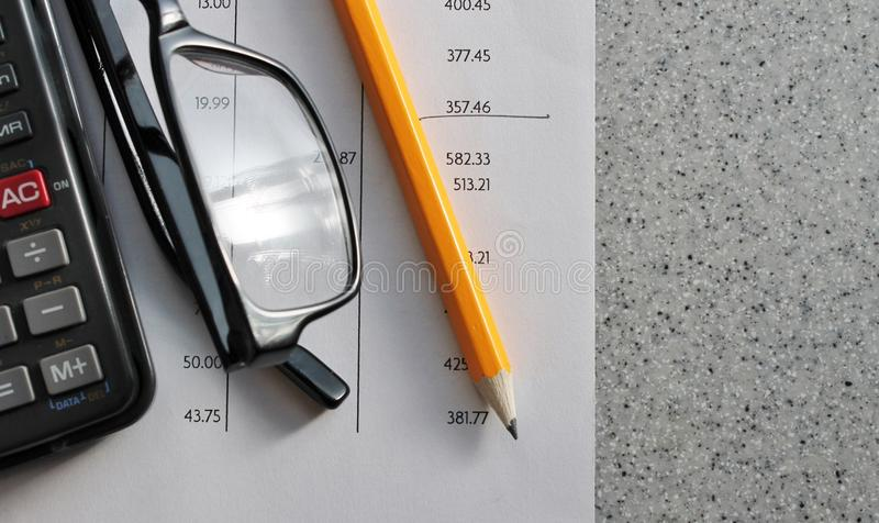 Bank statement with pencil glasses and calculator. Bank statement with pencil and calculator with glasses stock photos