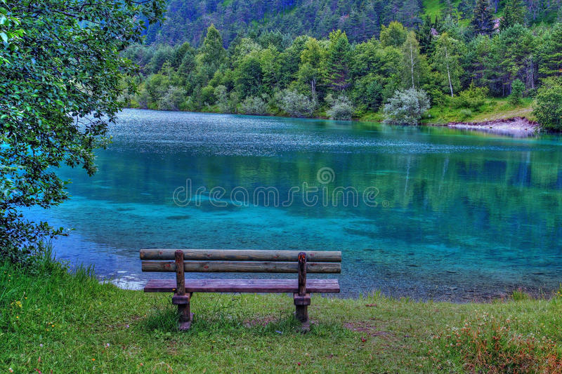 Download A Bank In The Turquoise-blue Lake Stock Image - Image: 25773511