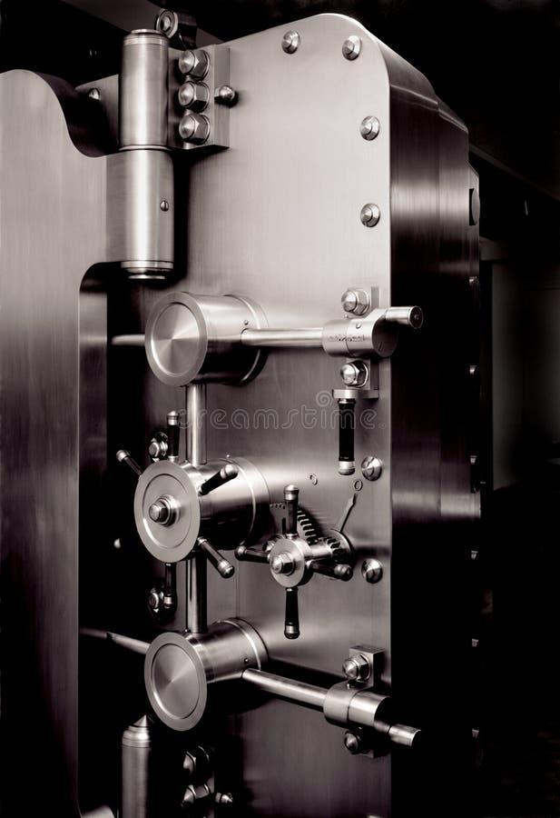 MONEY BANK VAULT DOOR, FINANCIAL PLANNING, WEALTH MANAGEMENT. Strength of the American money system shown by bank vault door, retirement saving, wealth royalty free stock images