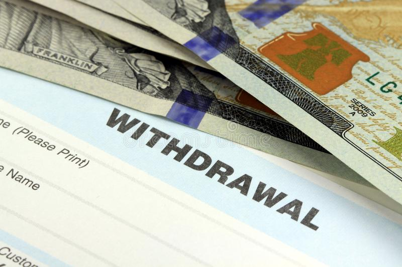 Bank withdrawal slip. Closeup of bank withdrawal slip with US currency - Banking concept royalty free stock photos