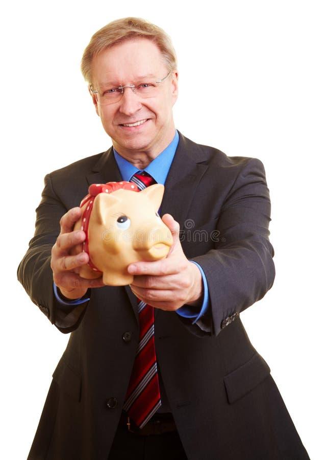 banka biznesmena offerering prosiątko zdjęcia royalty free