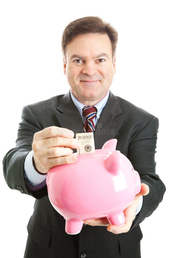 banka biznesmena szczęśliwy prosiątko ratuje obraz royalty free