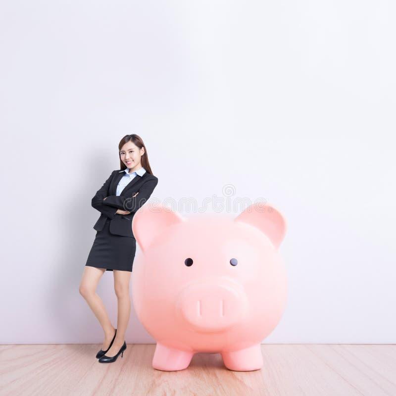 banka biznesowa prosiątka kobieta zdjęcia royalty free