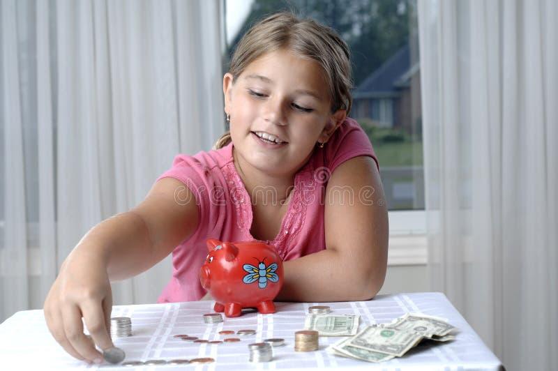 banka dziewczyny prosiątka szkoła obraz stock