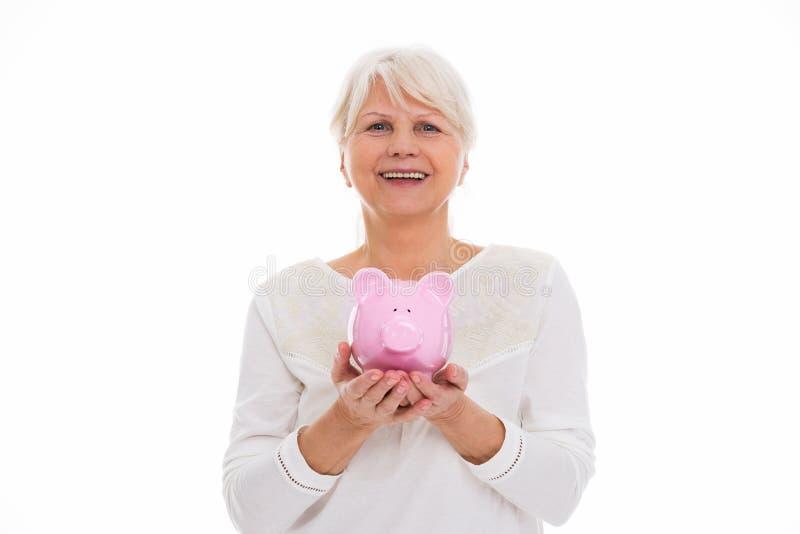 banka mienia prosiątka seniora kobieta obraz stock