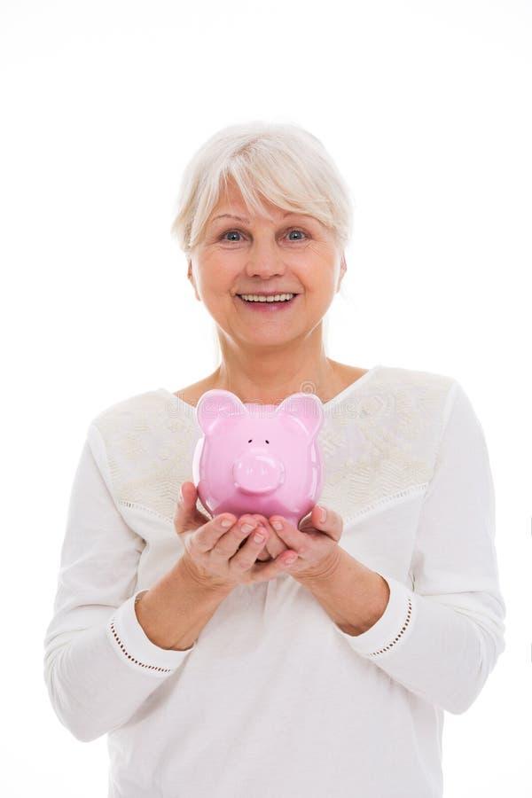 banka mienia prosiątka seniora kobieta zdjęcia stock